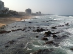 Washing the boulders along the beach in Umhlanga, South Africa.